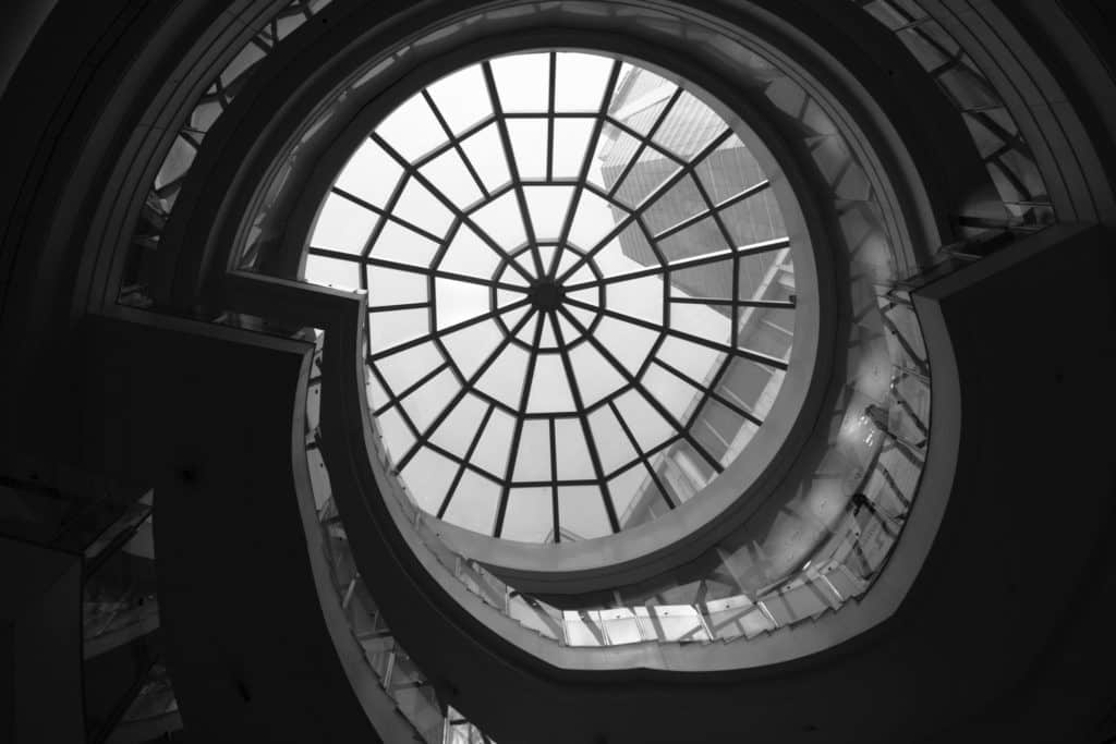 low-angle photo of clear glass ceiling