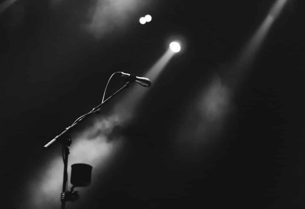 photo of microphone on foggy stage