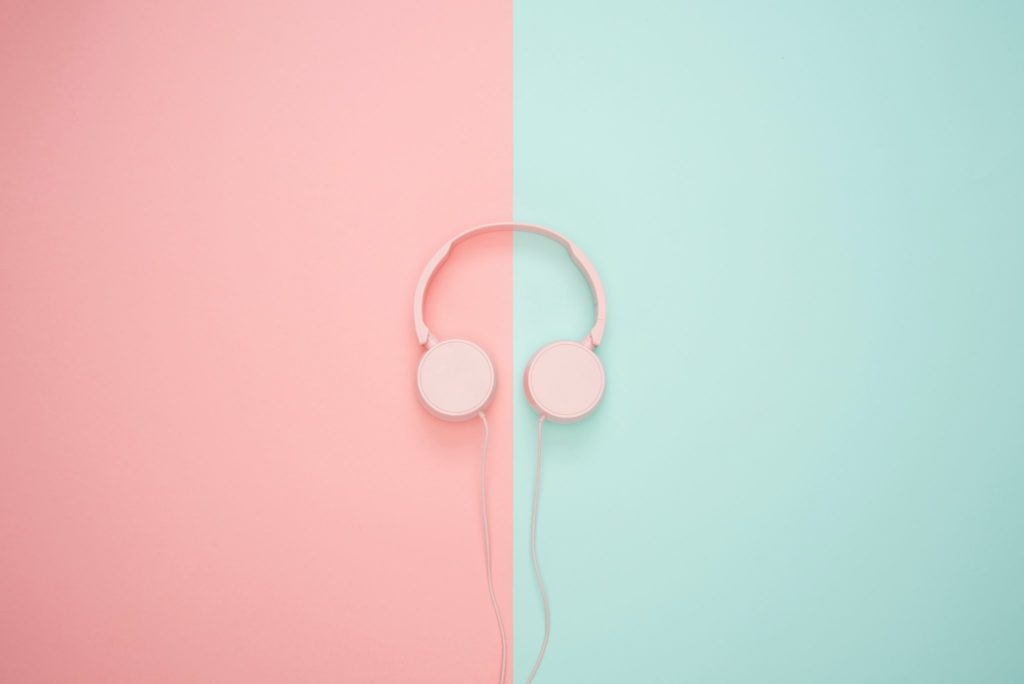 Pink headphones on a pastel background