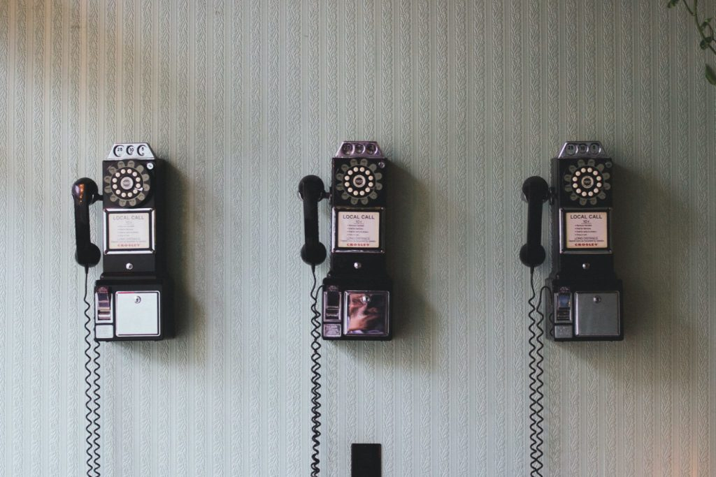 vintage telephone on the wall.