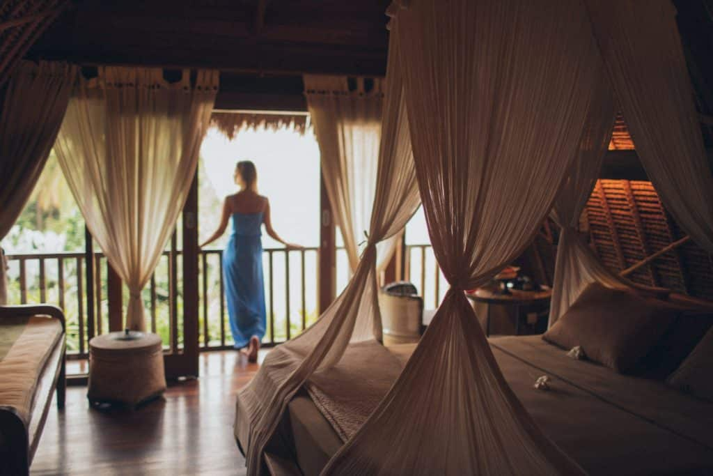 Woman leaning on handrail in room