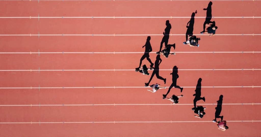 Working on a project for my school's track team on a summer morning. I noticed the sun was perfectly angled to expand the shadows of the runners into full size. I launched my Mavic Pro to 300 ft. and made them run in arrow shape.  Which I was able to capture this interesting overhead shot of them running and their shadows be an identical profile shot of them.